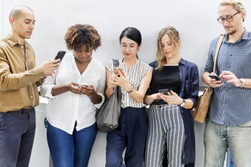 Group of diverse people using smartphones