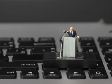 online conference concept-miniature speaker at Business Conference on laptop computer
